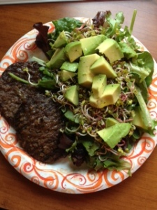 Beef patties with mixed greens, avocado and radish sprouts. Low carb and yummy to boot!