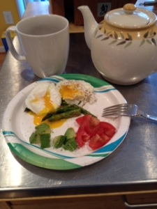 Eating my go to breakfast - 2 eggs, 1/2 tomato and 1/4 avocado. This morning I added the left over asparagus and poached my eggs for a twist on my staple morning meal.