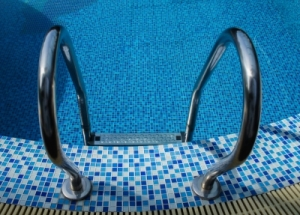 Swimming let's me workout without any weight on my knee. But if I buy a swimsuit now I'd have replace it in April. Decisions, decisions. Image courtesy of Rawich and FreeDigitalPhotos.net.