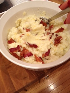 Once the cauliflower puree is ready, just mix in the bacon and cheddar cheese. The key is keeping the puree warm. If it cools, just nuke it for a minute in the microwave before adding the bacon and cheese.