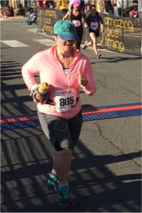The big action shot of me crossing the finishing line of my first 5K where I ran the entire 3.1 miles. I am awesome!