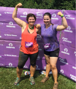 Success! Celebrating completing my first mud run with new friend Rebecca!